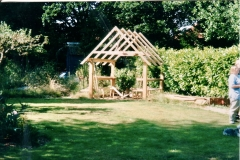 The garden house under construction: The garden was a neglected apple orchard. The trees were removed to make way for the new garden but one was used to turn a simple table into a feature in the garden house.