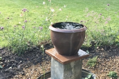After - A budget water feature. The wash tub and metal planter,  sourced from a secondhand yard, with left over pamments and topped with a pot purchased in an end-of-line sale. Total cost for water feature was about £150, most of which was the solar pump.